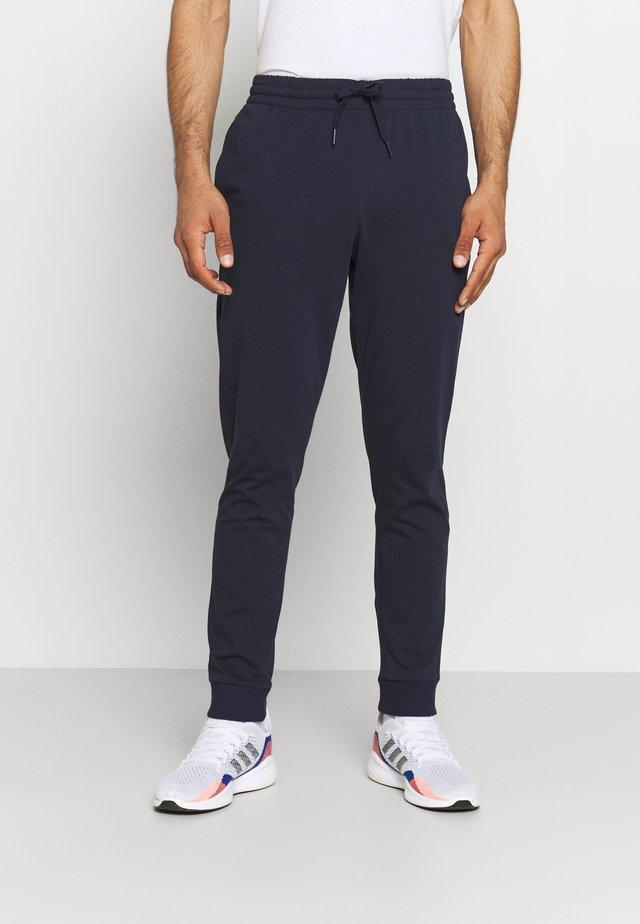 Pantalones deportivos - legend ink