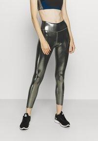 Nike Performance - ONE - Leggings - black/metallic gold - 0