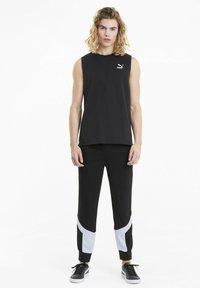 Puma - ICONIC MCS - Pantalon de survêtement - puma black - 1