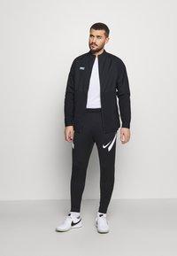 Nike Performance - Training jacket - black/black/white/clear - 1