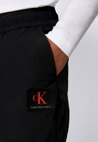 Calvin Klein Jeans - SEAMED PANT - Trousers - black - 3