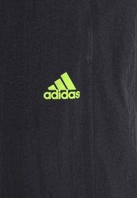 adidas Performance - ULTRA PANT - Trainingsbroek - black/yellow - 6