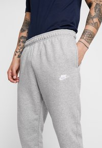 Nike Sportswear - CLUB - Tracksuit bottoms - dark grey heather/matte silver/white - 4