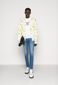 Versace Jeans Couture - DRILL - Slim fit jeans - light-blue denim - 1