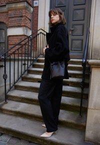 Mansur Gavriel - MINI MINI BUCKET - Across body bag - black/flamma - 0