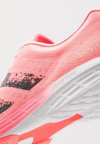 adidas Performance - ADIZERO BOUNCE SPORTS RUNNING SHOES - Zapatillas de competición - signal pink/core black/footwear white - 5