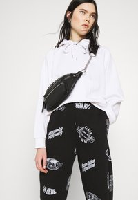 Topshop - VIRTUAL REALITY - Tracksuit bottoms - black - 3