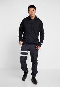 Nike Performance - FC HOODIE - Hoodie - black/white - 1