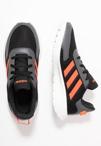 adidas Performance - TENSAUR RUN - Neutral running shoes - core black/solar red/grey six - 0