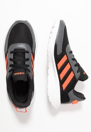 TENSAUR RUN - Neutral running shoes - core black/solar red/grey six
