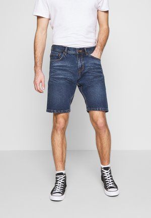 LOOSE FIT - Denim shorts - antique indigo