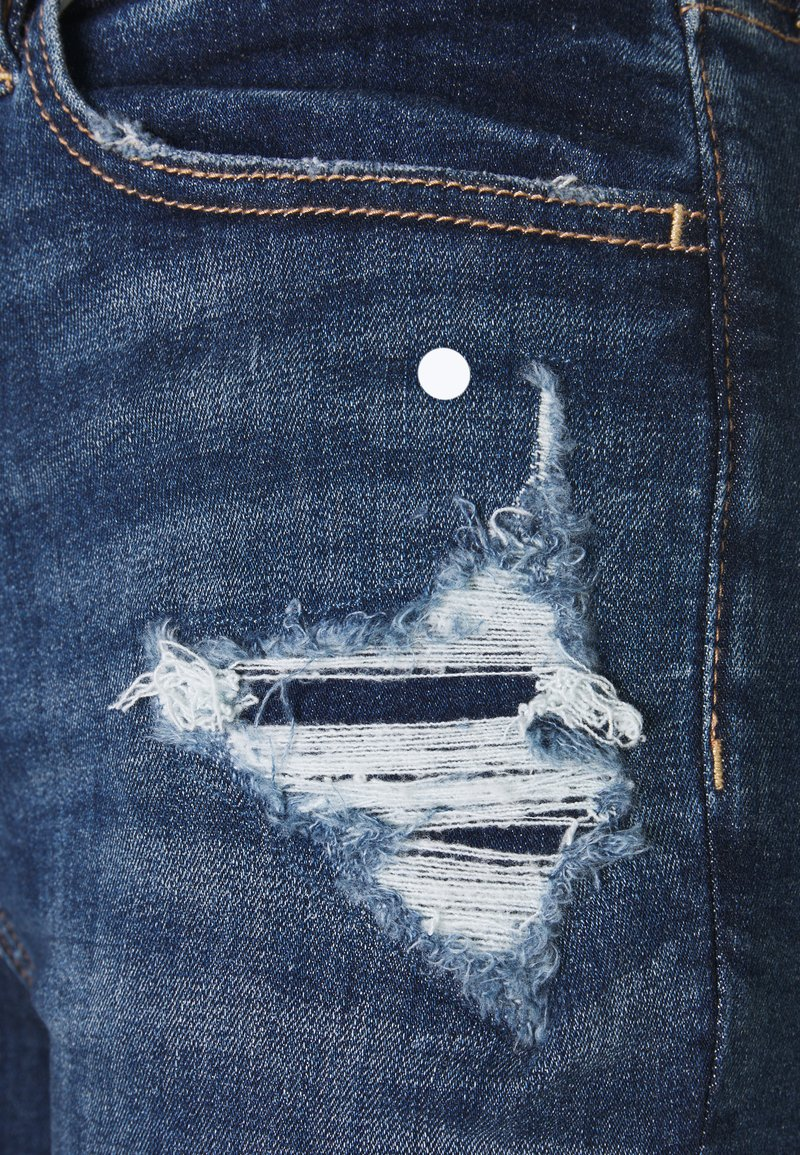 American Eagle SUPER HI RISE - Jeans Slim Fit - shadow patched blues/destroyed denim Mt0y64