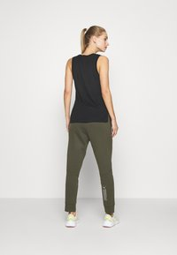 Puma - NU-TILITY PANTS - Pantaloni sportivi - forest night - 2
