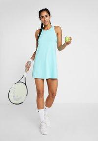 Nike Performance - DRY DRESS - Sportovní šaty - light aqua/white - 1