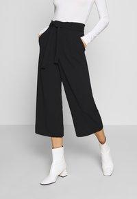 JDY - JDYTANJA CULOTTE ANKLE PANT - Trousers - black - 0