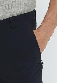 Mammut - RUNBOLD PANTS  - Pantalon classique - black - 3