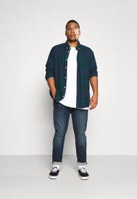 Levi's® Plus - 512 SLIM TAPER - Jeans Tapered Fit - brimstone adv - 1