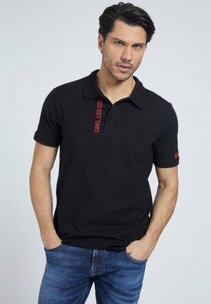 LOGO-DREIECK - Polo shirt - schwarz