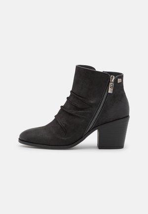 NEW PALAS - Korte laarzen - black