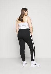 Even&Odd - Spodnie treningowe - black/white - 2