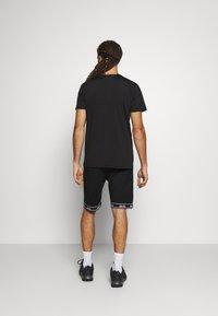 Ellesse - FASTELLO - T-shirt imprimé - orange - 2