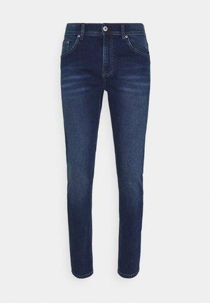 SUPERFLEX - Slim fit jeans - flax blue