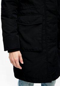 s.Oliver - MIT PLÜSCH-DETAILS - Winter coat - black - 6