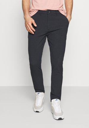 UGGE - Trousers - dark navy melange