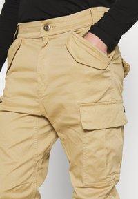 Alpha Industries - AIRMAN - Cargo trousers - sand - 3