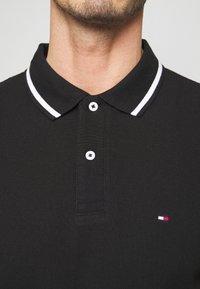 Tommy Hilfiger - Polo shirt - black - 5