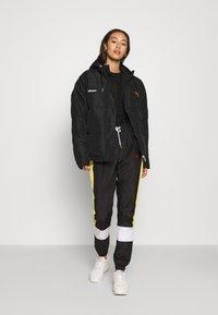 Ellesse - PEJO - Winter jacket - black - 1