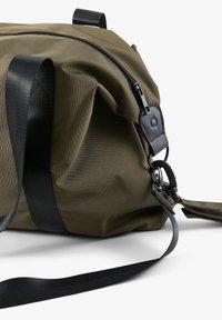 MAMALICIOUS - Baby changing bag - ivy green - 1