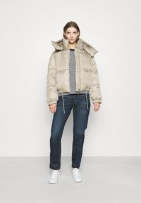 Weekday - HANNA SHORT PUFFER JACKET - Winter jacket - beige - 1