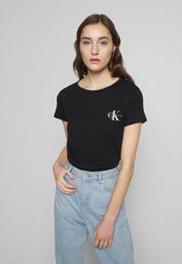 Calvin Klein Jeans - SLIM 2 PACK - Print T-shirt - black - 1