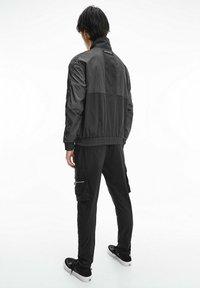 Calvin Klein Jeans - Windbreaker - black - 2
