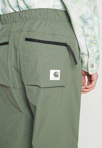 Carhartt WIP - HURST PANT - Tracksuit bottoms - dollar green - 5