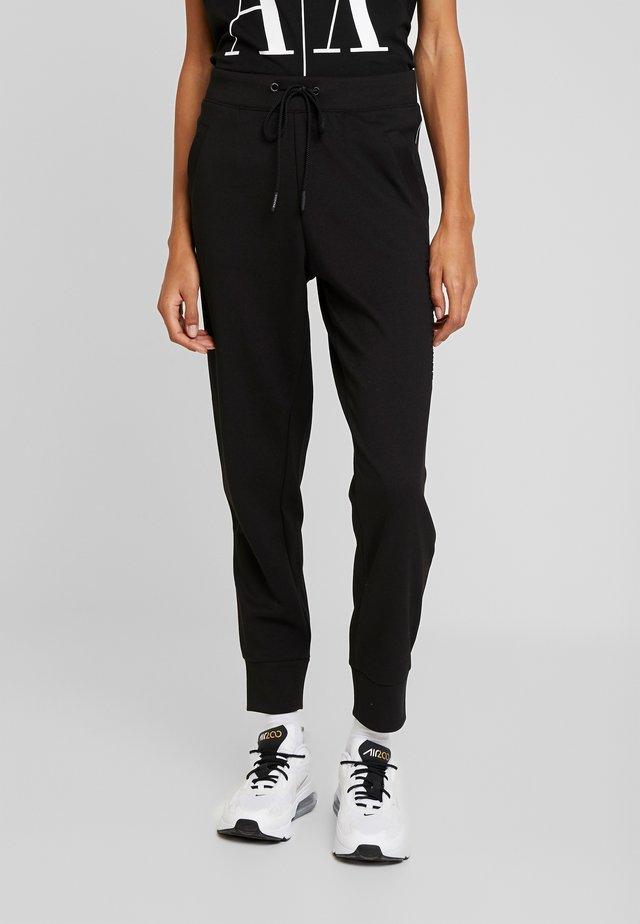 TROUSER - Spodnie treningowe - black