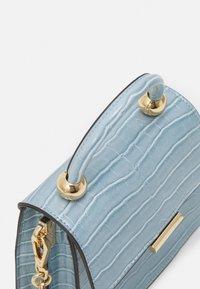ALDO - TRIEWIEL - Handbag - cashmere blue - 3