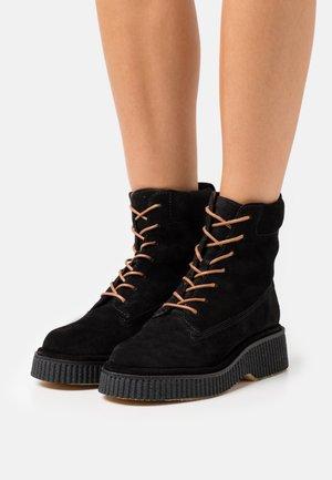 SLOANE BOOT - Platform ankle boots - black