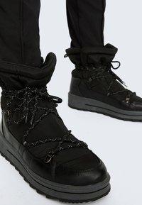 OYSHO - Lace-up ankle boots - black - 1