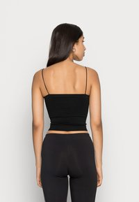 BDG Urban Outfitters - BUNGEE STRAP TUBE - Top - black - 2
