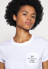 KARL LAGERFELD - ADDRESS LOGO POCKET - Print T-shirt - white - 3