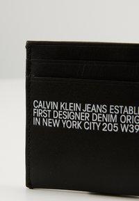 Calvin Klein Jeans - CARDCASE - Peněženka - black - 4