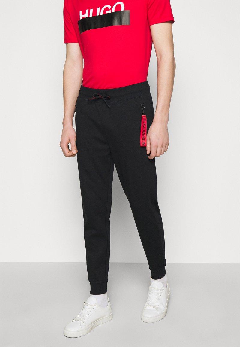 HUGO - DEASTY - Pantaloni sportivi - black