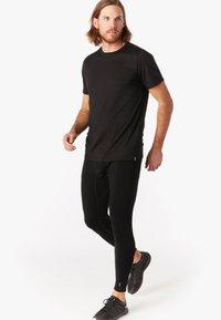 Smartwool - T-shirt basic - black - 0