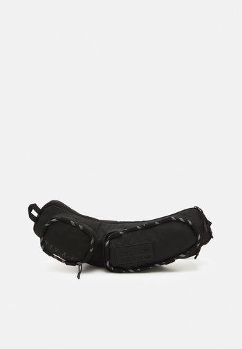 RYV UNISEX - Bum bag - black