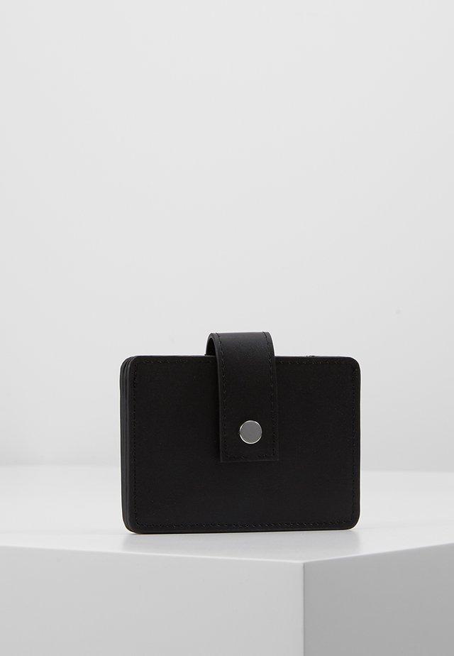 LEATHER - Lompakko - black