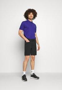 Calvin Klein Golf - PLANET - Polo shirt - indigo - 1
