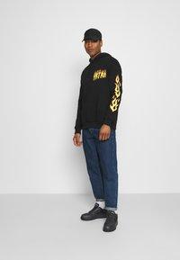 YOURTURN - UNISEX - Sweatshirt - black - 1