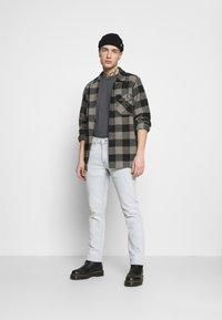 Levi's® - 511™ SLIM - Slim fit jeans - light indigo/flat finish - 1